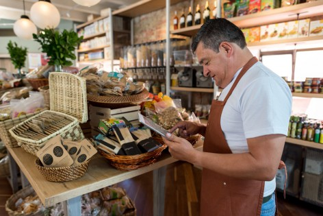 Business owner doing the inventory at a grocery shop - small business concepts