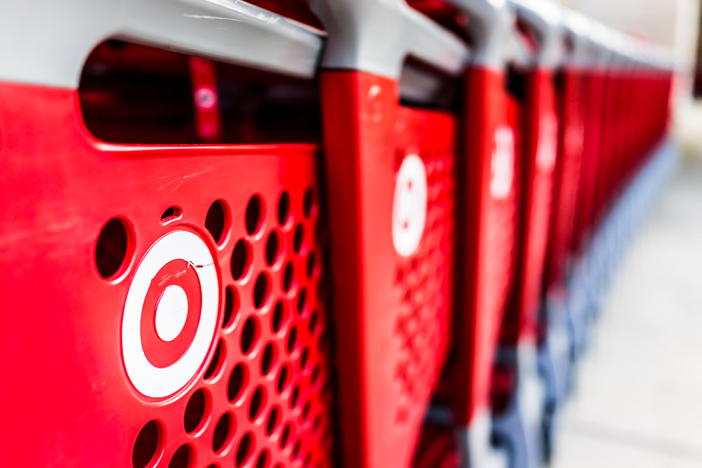 Fairfax: Many rows of red shopping carts outside by store with closeup by Target store parking lot